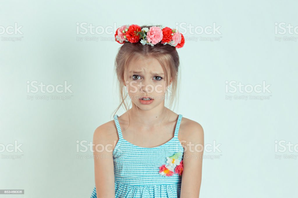 Closeup portrait Angry young Girl about to have Nervous atomic breakdown displeased isolated white wall background. Negative human emotions Facial Expression feeling attitude reaction body language stock photo