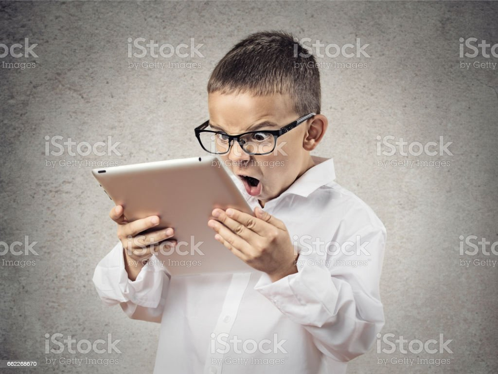 Closeup portrait child, shocked, surprised, funny looking boy stock photo