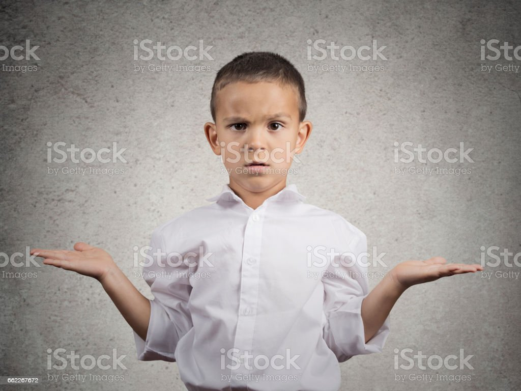 Closeup portrait clueless, unhappy child boy with arms out stock photo