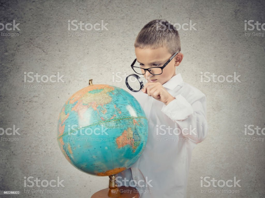 Closeup portrait curious child holding earth globe map royalty-free stock photo