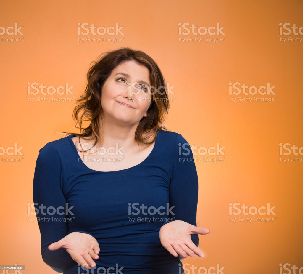Closeup portrait dumb young woman, arms out asking what's problem, who cares so what stock photo