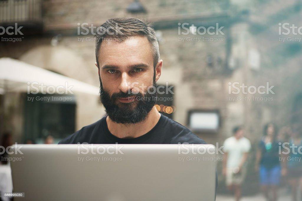 Closeup Portrait Handsome Bearded Businessman Wearing Black Tshirt Working Laptop стоковое фото
