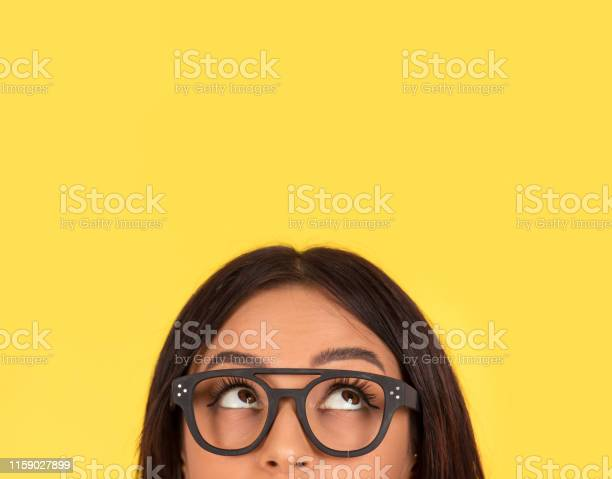 Photo of closeup portrait headshot cute happy woman in glasses looking up