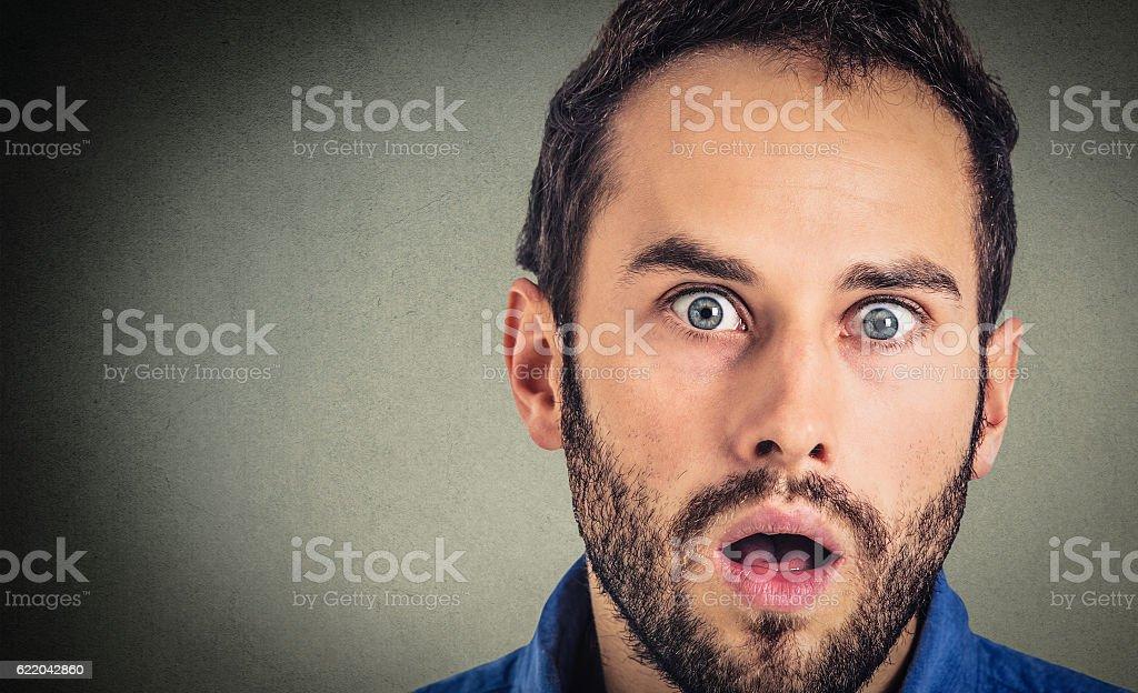 Closeup portrait man looking surprised stock photo