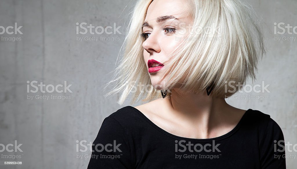 Close-up portrait of a beautiful blonde with red lips stock photo