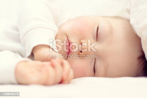 istock close-up portrait of a beautiful sleeping baby on white 133848079