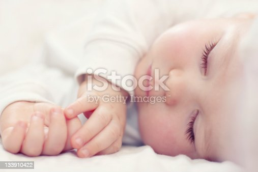 133910422 istock photo close-up portrait of a beautiful sleeping baby on white 133910422