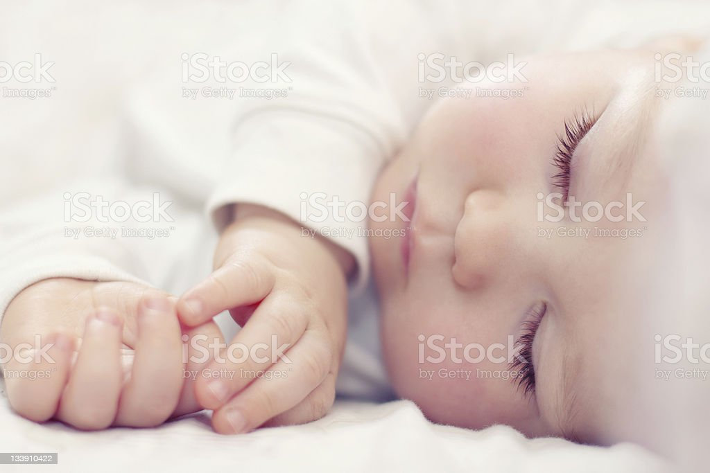 close-up portrait of a beautiful sleeping baby on white stock photo