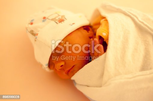 istock Close-up portrait of a beautiful sleeping baby on white 898399028