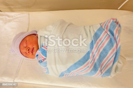 istock Close-up portrait of a beautiful sleeping baby on white 898399092