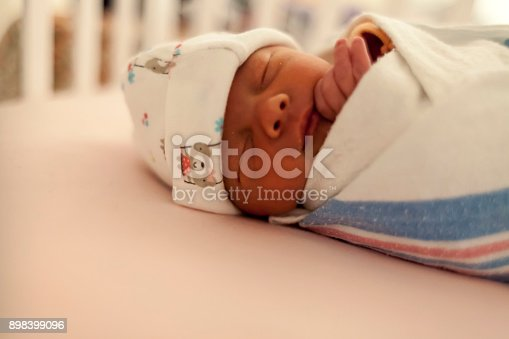 istock Close-up portrait of a beautiful sleeping baby on white 898399096