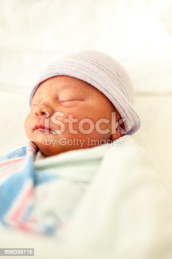 133910422 istock photo Close-up portrait of a beautiful sleeping baby on white 898399116