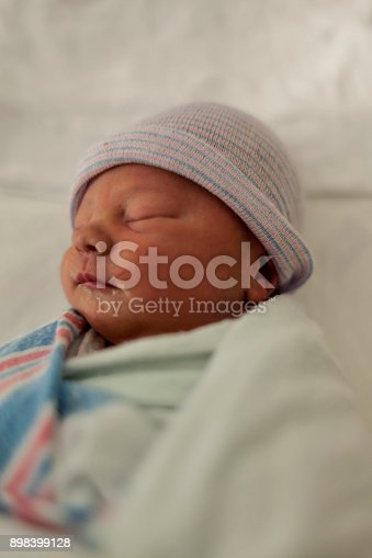 istock Close-up portrait of a beautiful sleeping baby on white 898399128