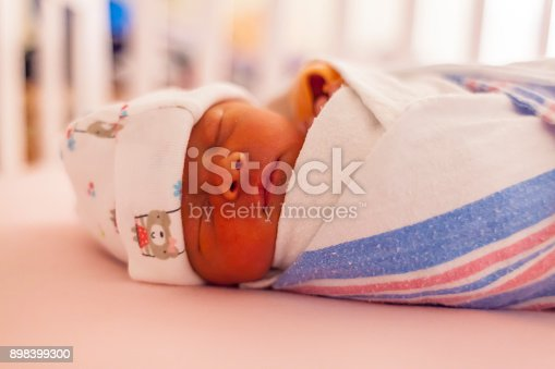 133910422istockphoto Close-up portrait of a beautiful sleeping baby on white 898399300