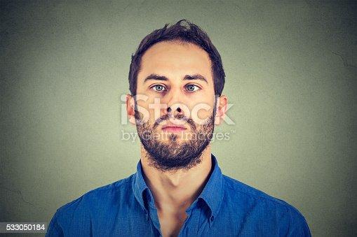 istock Closeup portrait of a cross-eyed man 533050184