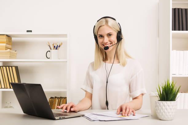 close-up portrait of a customer service agent sitting at office - call center стоковые фото и изображения