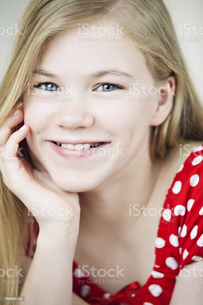 Close-up portrait of a cute 11-year old girl stock photo