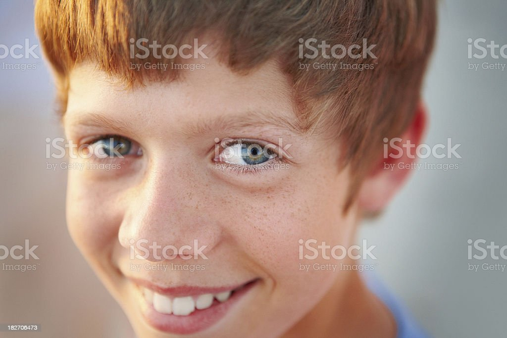 Closeup portrait of a cute smiling boy stock photo