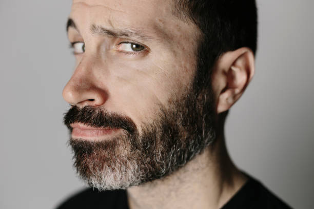 Close-up portrait of a expressive bearded middle-aged man stock photo