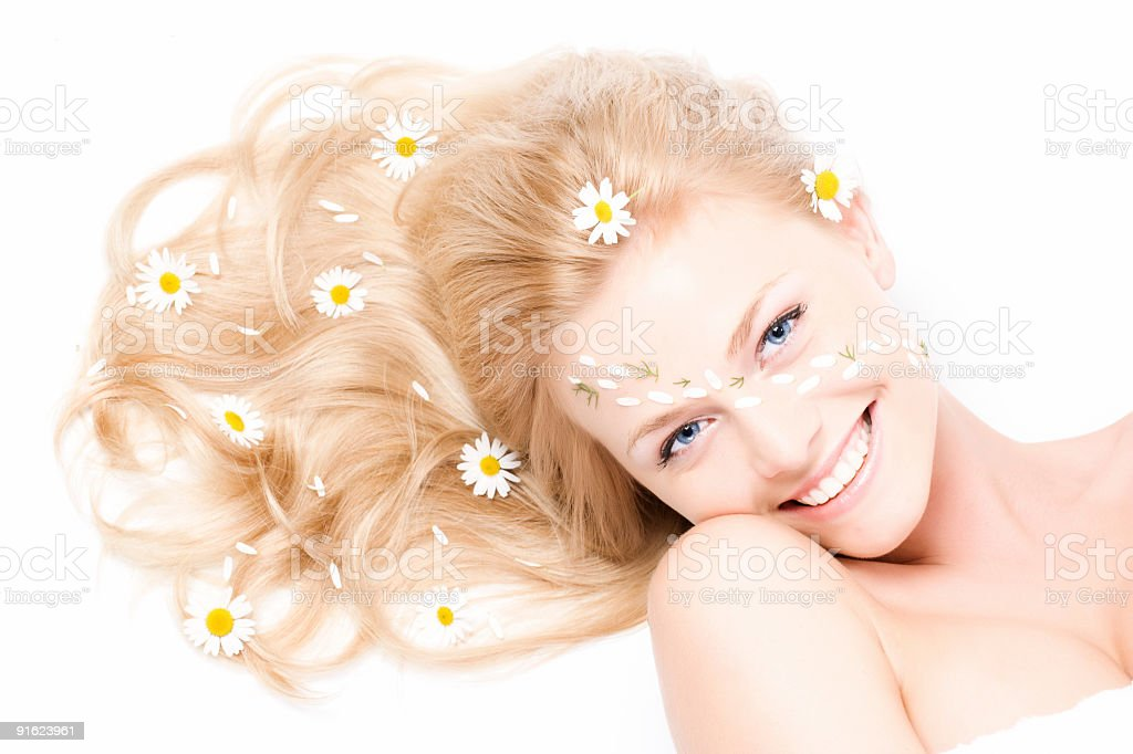 Close-up portrait of a fresh and beautiful woman with camomile royalty-free stock photo
