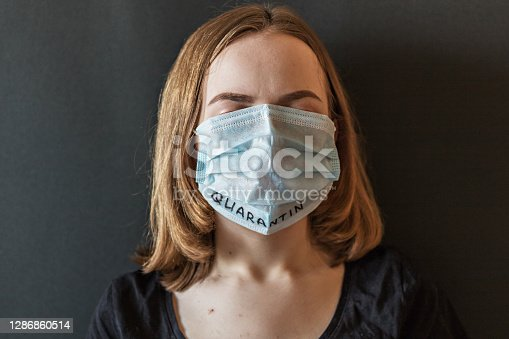 Close-up portrait of a girl in an icy mask on her face with suspected coronavirus. New Coronavirus-covid-2019. Chinese outbreak of coronavirus.