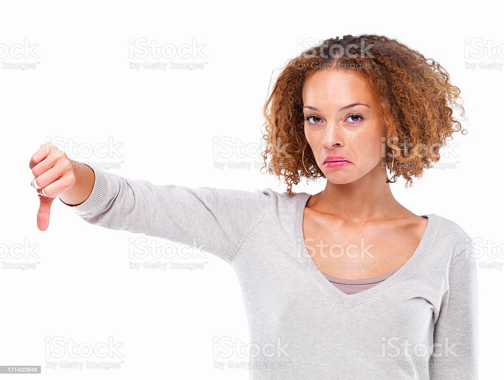 Closeup portrait of a girl with a thumb down sign isolated on white background stock photo