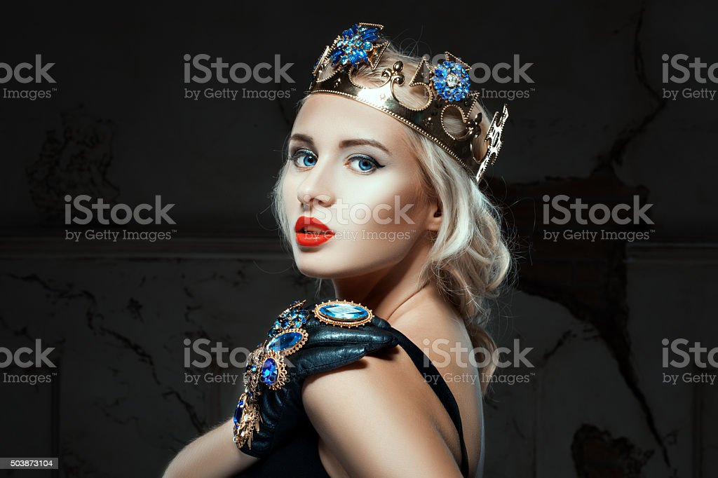 Close-up portrait of a girl with crown. stock photo