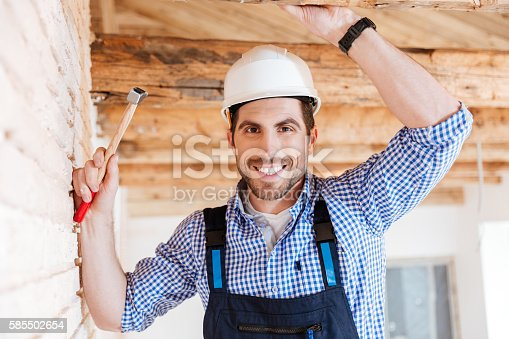 istock Close-up portrait of a handsome handyman 585502654