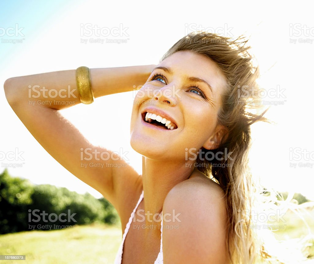 Closeup portrait of a happy young female posing in garden royalty-free stock photo