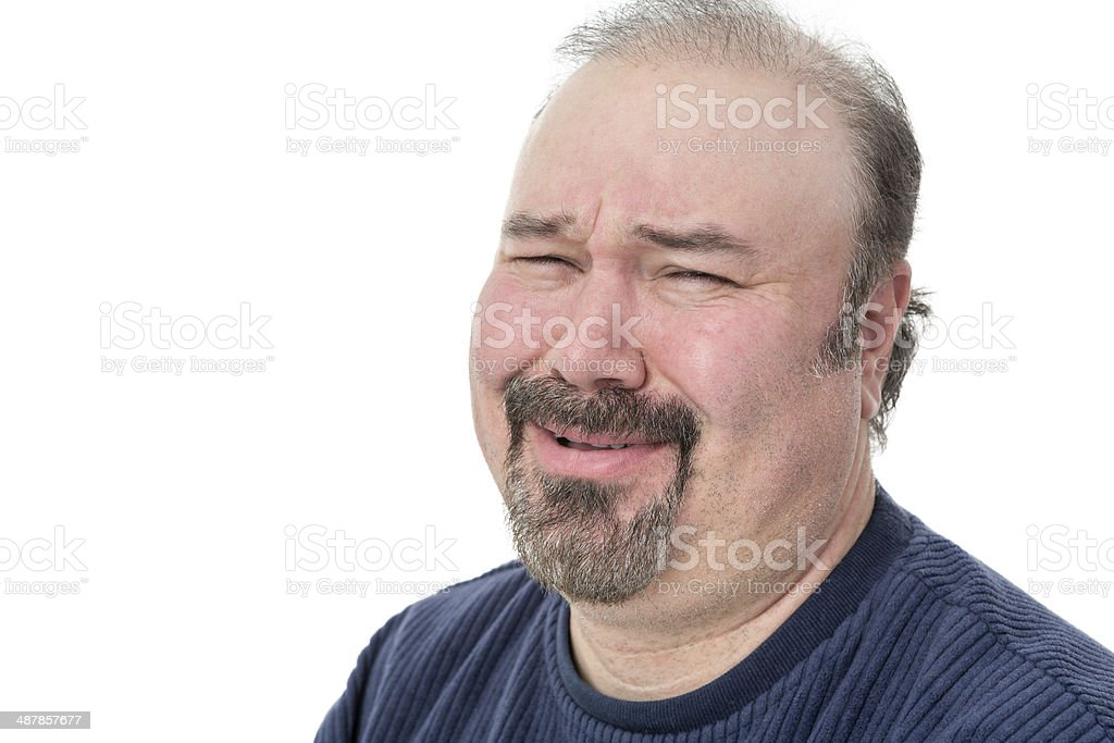 Close-up portrait of a man laughing in disbelief stock photo
