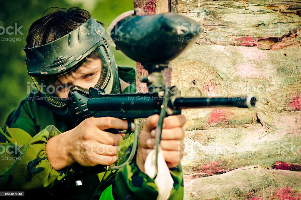 Close-up portrait of a paintball player stock photo