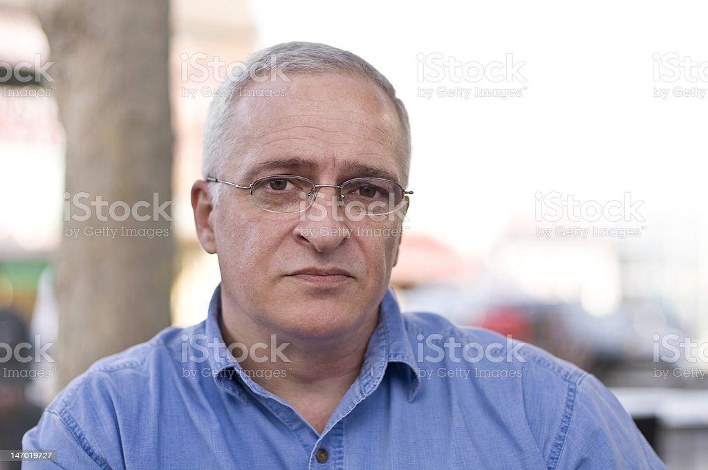 Close-up portrait of a sad senior man royalty-free stock photo