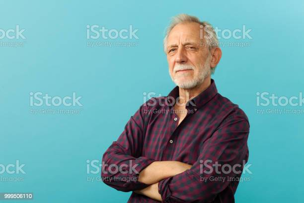 Closeup portrait of a senior men in studio on a blue background picture id999506110?b=1&k=6&m=999506110&s=612x612&h= sybyhlf6hxox2nwisq2lyqxxuh2j8cbtvw l3bty3w=