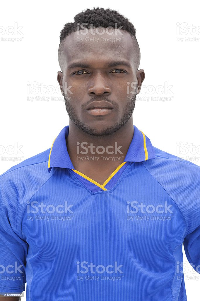 Close-up portrait of a serious football player stock photo