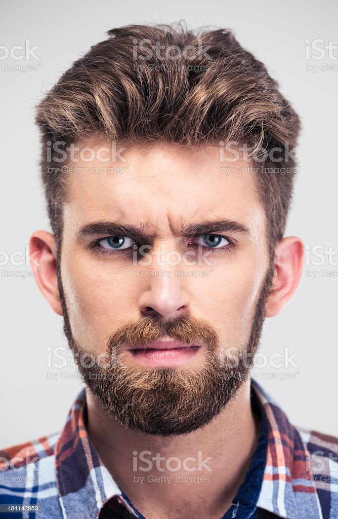 Closeup portrait of a serious man looking at camera stock photo