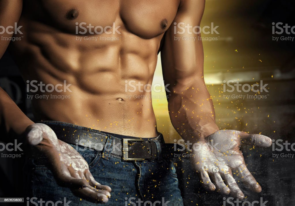 Closeup portrait of a sexy muscular man. Brutal bodybuilder athletic man with six pack, perfect abs, shoulders, biceps, triceps and chest stock photo