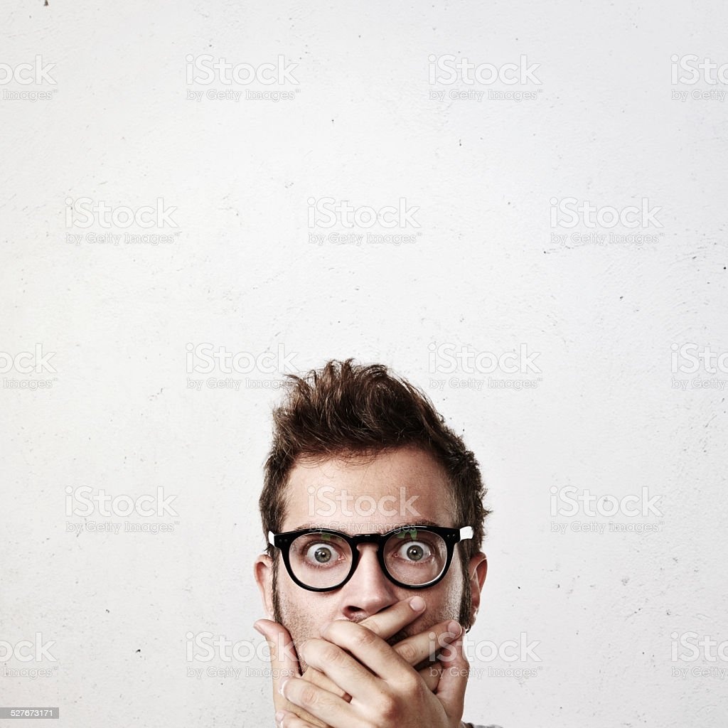 Close-up portrait of a shocked man stock photo