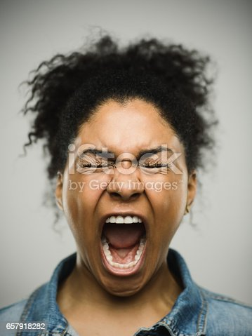 istock Close-up portrait of a shocked real young afro american woman 657918282
