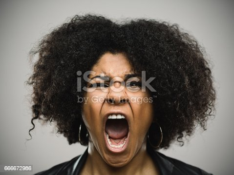 istock Close-up portrait of a shocked real young afro american woman 666672986