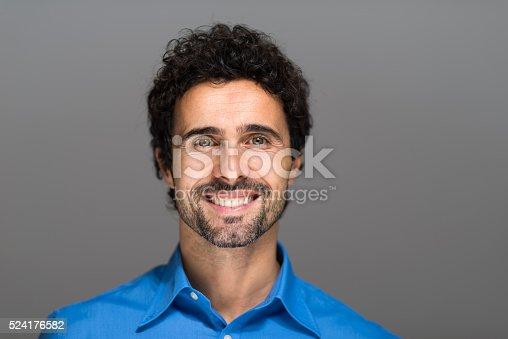 istock Closeup portrait of a smiling man. 524176582