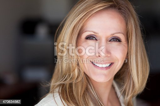 istock Close-up portrait of a smiling mature woman 470634582