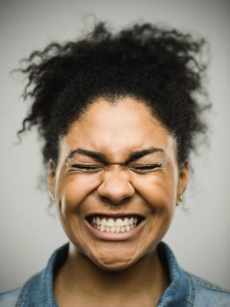 Close-up portrait of a stressed real young afro american woman stock photo