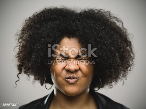 istock Close-up portrait of a stressed real young afro american woman 666673022