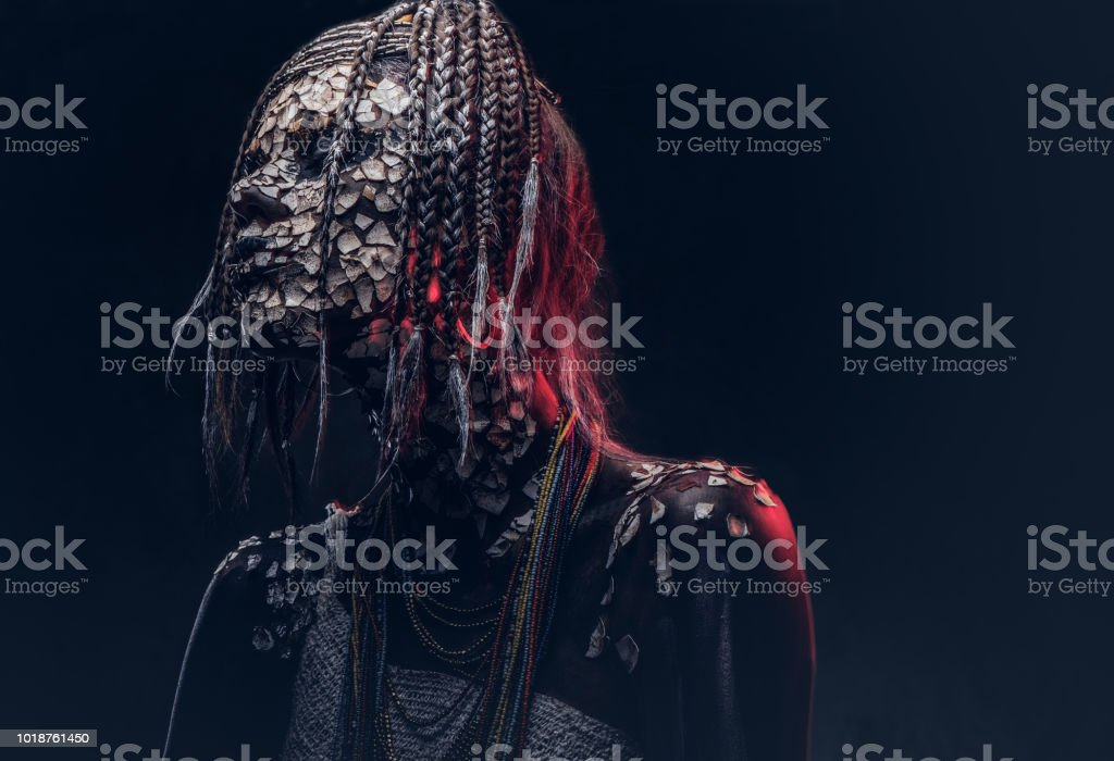 Close-up portrait of a witch from the indigenous African tribe, wearing traditional costume. Make-up concept. stock photo