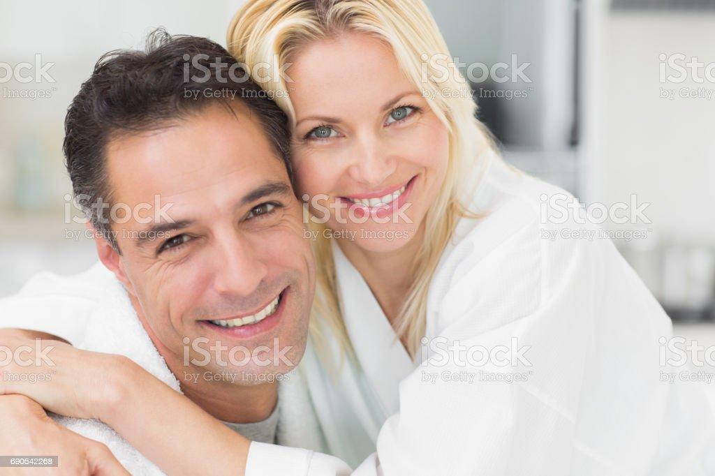 Closeup portrait of a woman embracing man stock photo