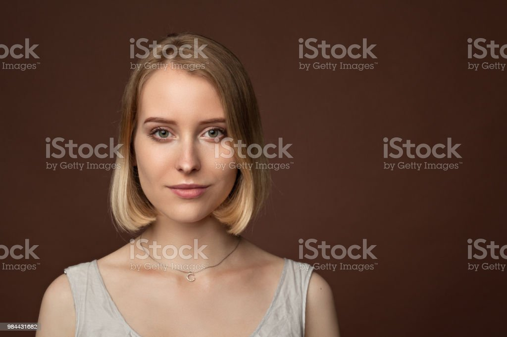 close-up portrait of a young attractive woman 20 years in a dress in...
