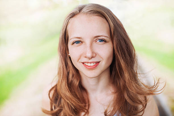 Close-up portrait of a young girl Smiling young woman outdoors dark spots face stock pictures, royalty-free photos & images