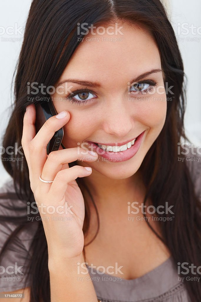 Closeup portrait of a young girl using cellphone royalty-free stock photo