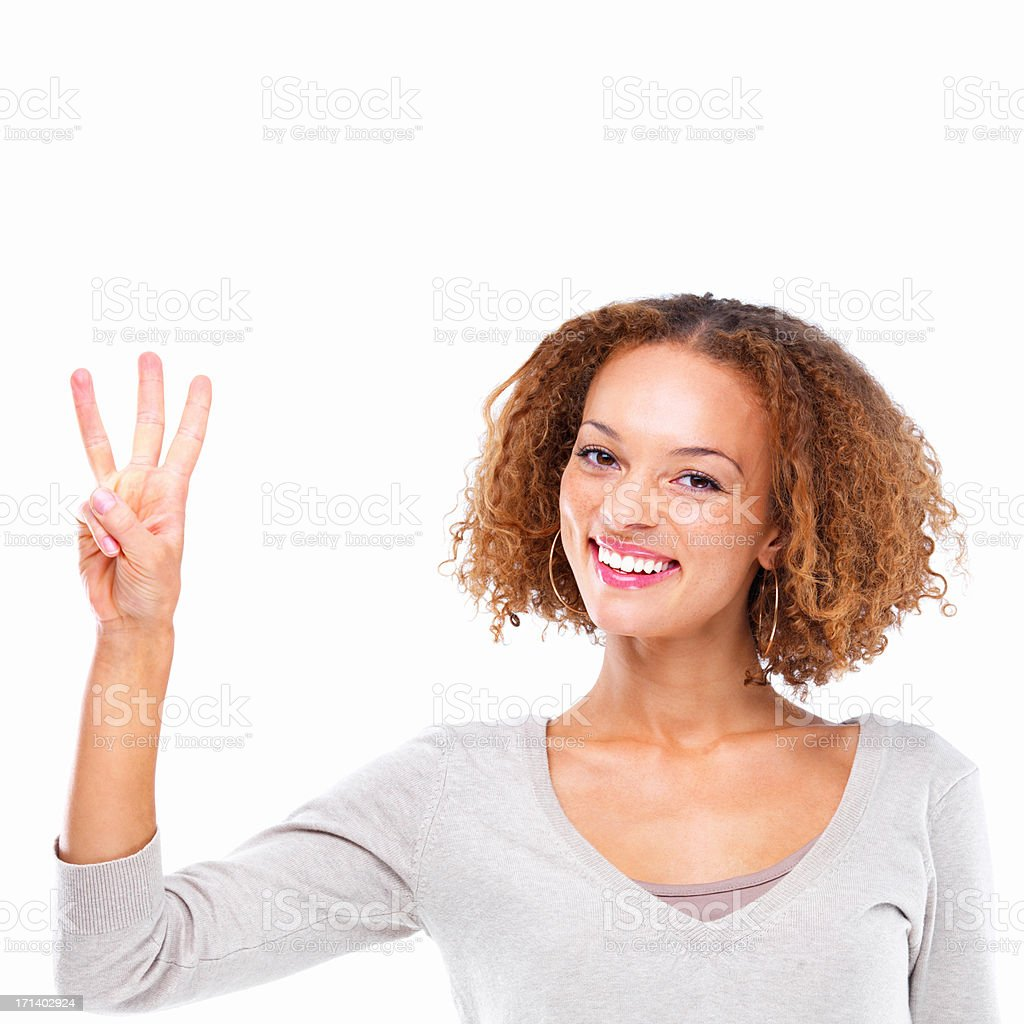 Closeup portrait of a young lady showing three fingers isolated on white background royalty-free stock photo