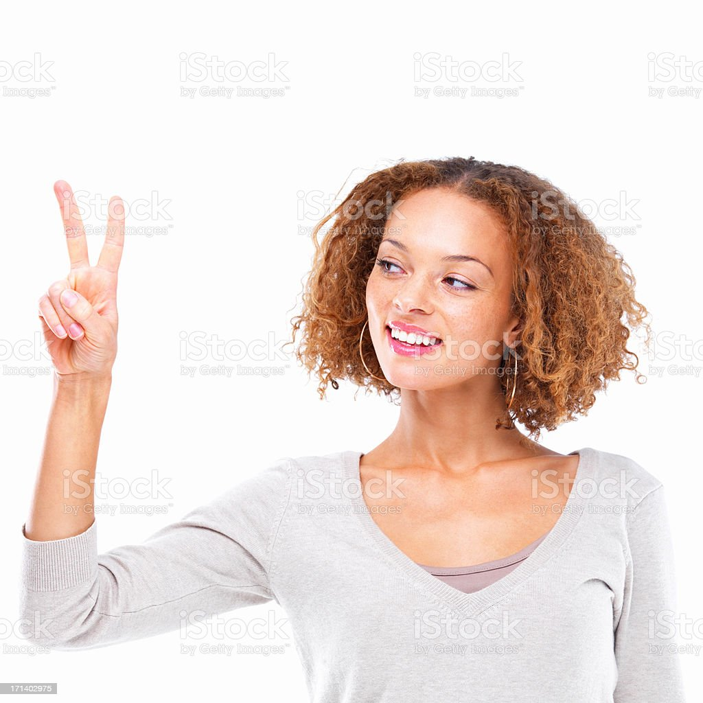 Closeup portrait of a young lady showing two fingers isolated on white background stock photo